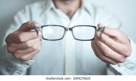 Optician showing glasses.