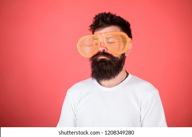 Optics and eye protection concept. Sunglasses party attribute and stylish accessory. Man bearded hipster wears giant louvered sunglasses. Hipster wear shutter shades sunglasses. Fashionable accessory.