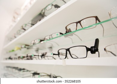 optics, health care and vision concept - close up of eyeglasses at optician