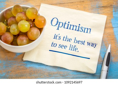 optimism - best way to see life, inspirational handwriting on a napkin with fresh grapes