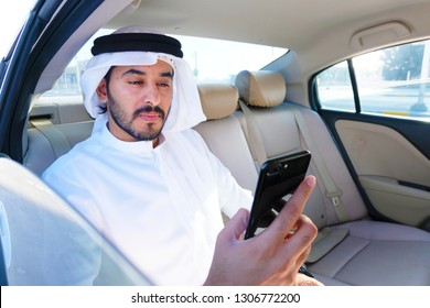 Optimistic Arabian business man reading the news about the market, trends or economy update in the Middle East.