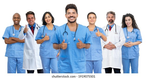 Optimistic latin american male doctor with motivated medical team isolated on white background for cut out