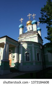 The Optina Pustyn Orthodox monastery for men near Kozelsk in Russia in summer sunny day, white church with colums, domes