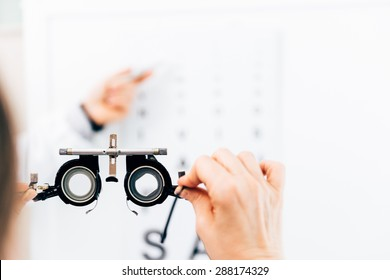 Optometrist doing sight testing for patient