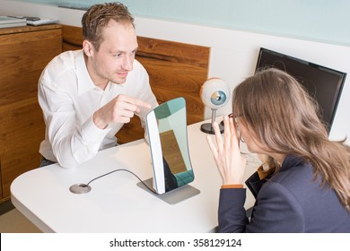 Optometrist during lens measurement with a centration system