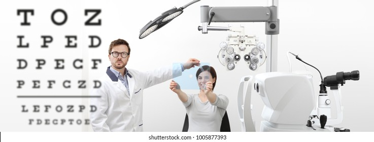 optometrist examining eyesight woman patient pointing chart at the hole on plexiglass in optician office, ocular dominance test