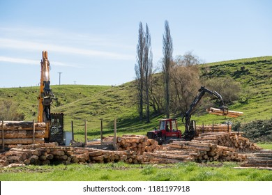 Opuha, South Canterbury, New Zealand: September 14 2018: Logging machines load up a truck with logs at a forestry site