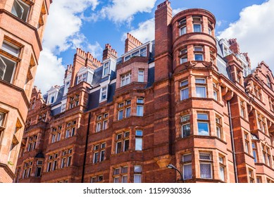 Opulent British Victorian terraced luxury residential building in red bricks in Mayfair, London, UK