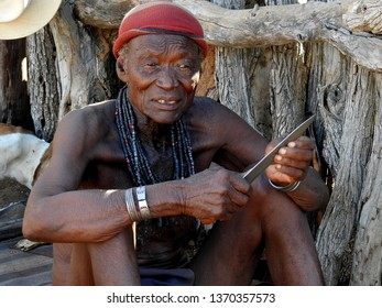 Opuwa, Kunene Region, Namibia, May 10, 2017: Himba people wear a colourful necklace, near epupa falls.