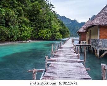 Ora Beach, Indonesia - February 12, 2018: Houses on the water  in Ora Beach Resort, Seram Island, Central Maluku, Indonesia