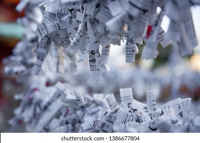 Oracles at Japanese traditional shrine. Chiyoda district Tokyo Japan - 02.07.2019 : It s a Japanese oracle called OMIKUJI at the traditional shrine. Translation on oracles text fortune . camera