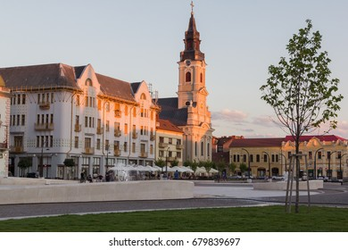 ORADEA, ROMANIA - July 13: Moon Church(Biserica cu Luna) and Union Square(Piata Unirii) by evening on July 13, 2017 in Oradea