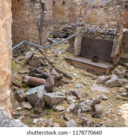 Oradour sur Glane / France - Aug. 31, 2018: Remains of a chimney in the ruins of the village that was burned and its 642 inhabitants murdered by an SS regime on June 4, 1944. Now a memorial place.