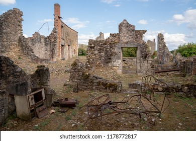 Oradour sur Glane / France - Aug. 31, 2018: Remains of a bed amidst the ruins of the village that was burned and its 642 inhabitants murdered by an SS regime on June 10, 1944. Now a memorial place.