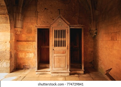 ORADOUR SUR GLANE, FRANCE - December 03, 2017 : inside the church after the massacre of the population by the Nazis on June 10, 1944, the wooden confessional retained almost intact since that time