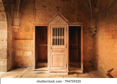 ORADOUR SUR GLANE, FRANCE - December 03, 2017 : inside the church where were burned women and children during the massacre of the population, the wooden confessional retained almost intact