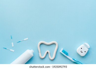 Oral care products flat lay. Toothbrushes with white tube of toothpaste and dental floss
