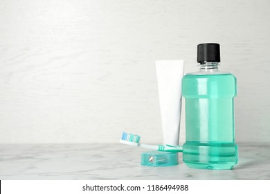 Oral care products and space for text on light background. Teeth hygiene