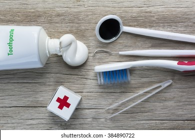 Oral health care equipment on a wooden background./ Oral health care equipment