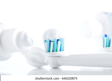 Oral hygiene accessory isolated on white background, toothpaste, toothbrush head