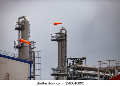 Oral region/Kazakhstan - May 24 2012: Oil refinery plant Zhaiyk-Munai. Safety technologies and things. Weather vane on distillation towers