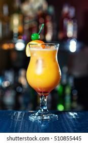 Orange alcohol cocktails at the bar