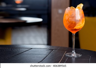 orange aperitif, a cocktail on the wooden table