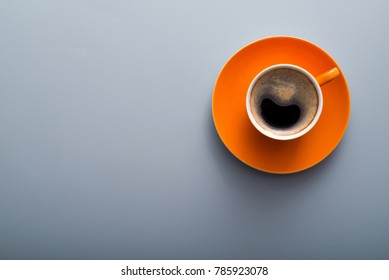 orange aroma coffee cup on a table, top view