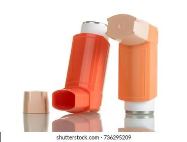 Orange asthma inhaler isolated on white background