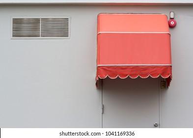 orange awning over steel door