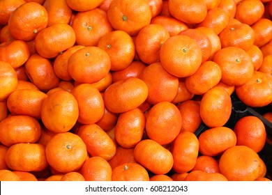 orange background clementines for sale at the greengrocer