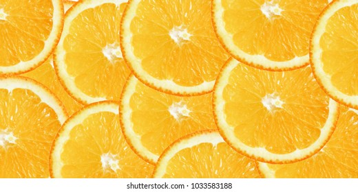 Orange background from orange slices. Citrus fruit. Top view. Healthy food.