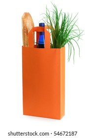 Orange bag with grocery goods including French bread, wine and spring onion