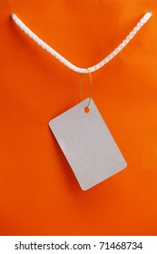 Orange bag with tag attached.
