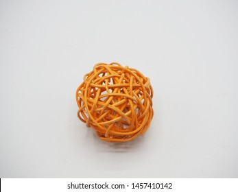 Orange ball made from thin branch isolated on white background
