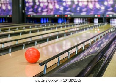 Orange ball on bowling alley
