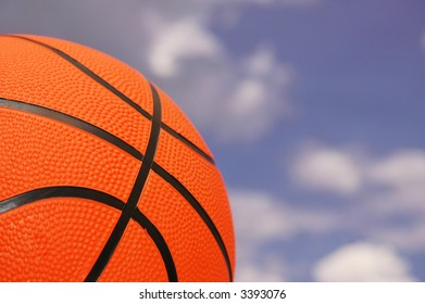 Orange basketball  against cloudy sky