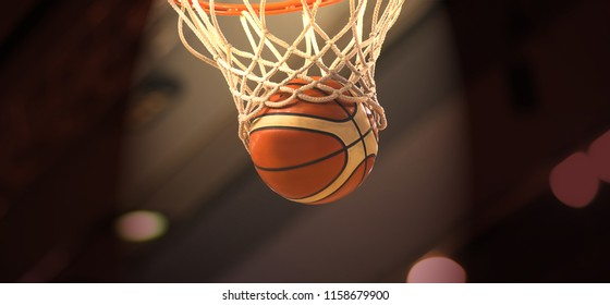 The orange basketball ball flies through the basket
