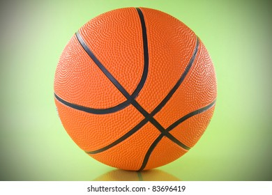 orange basketball ball over a green background.