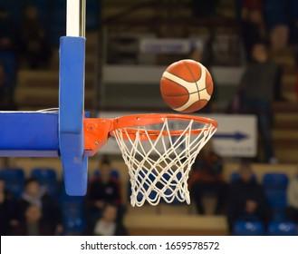 Orange basketball flies to the basket