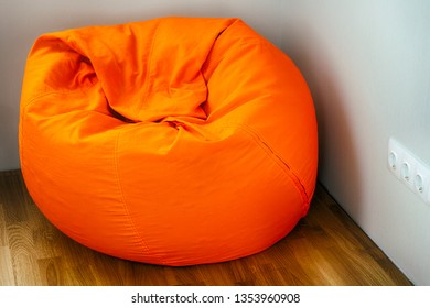Orange beanbag in room corner