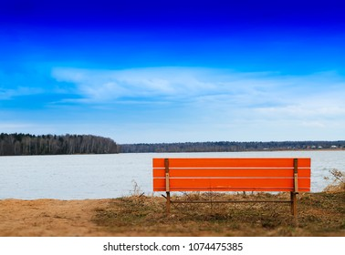 Orange bench on river beach horizon background hd
