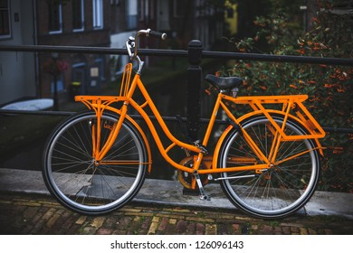 Orange bicycle on a bridge. Utrecht, The Netherlands