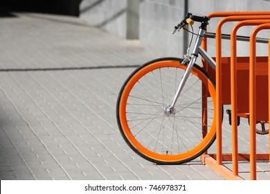 Orange bicycle stands on the orange bicycle park