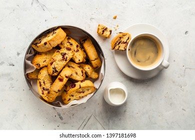 Orange biscotti with coffee and milk