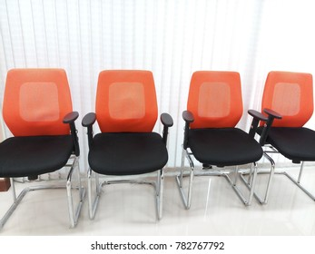 Orange and black chairs in the office