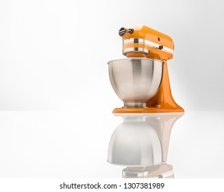 Orange Blender and Classic Retro Mixer taken in the studio at a unique angle with a reflection.