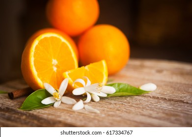 orange and orange blossom on rustic wood background