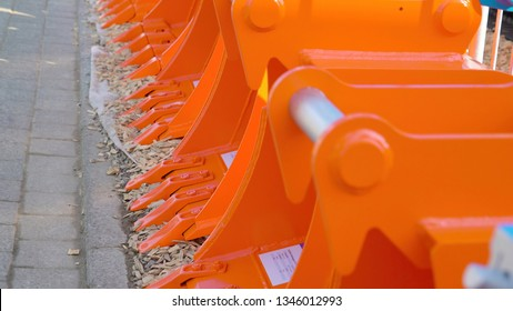 Orange and blue color log grapples in the construction site these are new grapples used for the industrial site