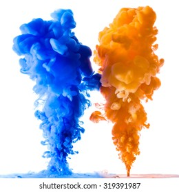 Orange and blue ink splashes in the water, isolated on white background
